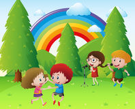 Children singing and dancing in park Royalty Free Stock Images