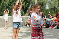 Children singing and dancing Royalty Free Stock Photos