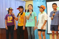 Children singing in school activities. BANGKOK, THAILAND - MAR 11, 2015: Unknown children, Children singing in school activities at Elementary School. bangkok at royalty free stock photography