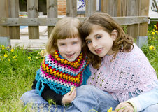 Children sister girls smiling in meadow Royalty Free Stock Images