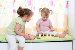 Children sisters play at home. Children sisters play together indoors Stock Images