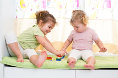 Children sisters play. Together indoors Royalty Free Stock Images