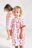 Children sisters play together on white background Stock Photos