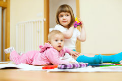 Children sits in home Stock Photos