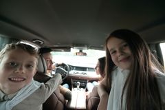 Children sitting in the back seat of the car. Family holiday Stock Photo