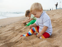 Children sitting on beach Royalty Free Stock Images