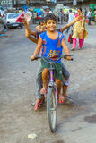 Children sitting on a bike early Stock Photos