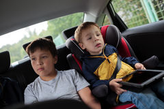 Children sitting in the car and looking at the Stock Image