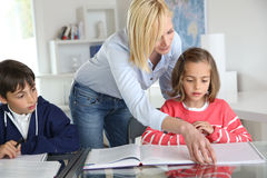 Teacher with kids at school Royalty Free Stock Photo