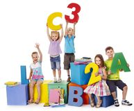Children sitting at cube. Stock Images