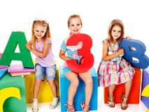 Children sitting at cube. Stock Photography