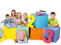 Children sitting at cube. Royalty Free Stock Photography