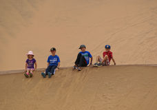 Children sitting on a dune Royalty Free Stock Images