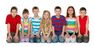 Children are sitting on the floor Stock Photos