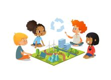 Children sitting on floor explore the model landscape, mountains, Eco-green city, plants, trees, solar panels and wind. Children sitting on floor explore toy Royalty Free Stock Images