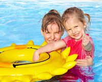 Children sitting on inflatable ring.. Royalty Free Stock Images