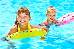 Children sitting on inflatable ring. Royalty Free Stock Photo