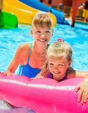 Children sitting on inflatable ring Stock Image