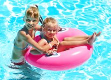Children sitting on inflatable ring. Royalty Free Stock Photography