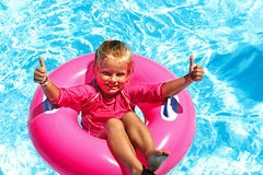 Children sitting on inflatable ring. Royalty Free Stock Photos