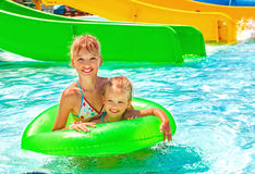 Children sitting on inflatable ring Stock Photo
