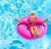 Children sitting on inflatable ring Stock Images