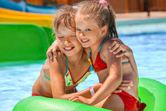 Children sitting on inflatable ring Royalty Free Stock Photos