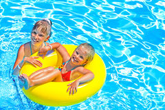 Children sitting on inflatable ring in water Royalty Free Stock Photography