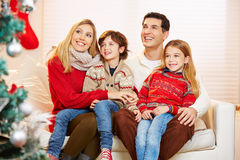 Children sitting on lap of their parents at christmas Royalty Free Stock Photo
