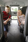 Children sitting in a school bus Royalty Free Stock Photography