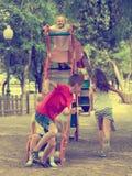 Children sitting on sliding toy Royalty Free Stock Photography