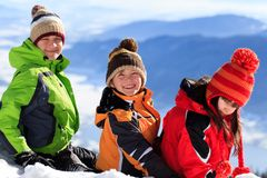 Children Sitting in Snow Royalty Free Stock Photos