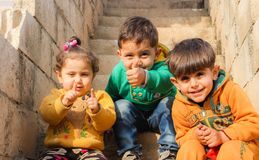 Children Sitting On The Stairs Doing Pose Stock Images