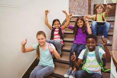 Children sitting on stairs in school Stock Image