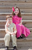Children sitting on step Stock Photo