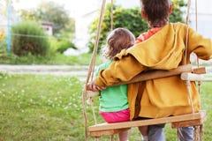 Older brother hugging little sister stock photos
