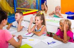 Children sitting together and studying in class at school royalty free stock image