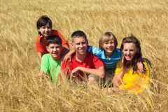 Children sitting in wheat field Royalty Free Stock Images
