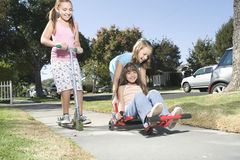 Children With Skateboard And Scooter Royalty Free Stock Images