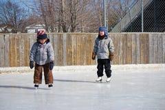 Children at the skating rink Royalty Free Stock Photo