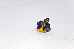 Children are skating at a toboggan Stock Photo