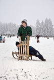 Children are skating at a toboggan Stock Images
