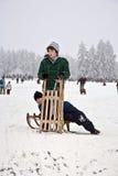 Children are skating at a toboggan Stock Images