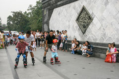 Children skating training with coach in a park,chengdu,china Stock Photos