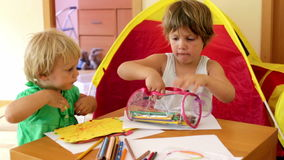 Children sketching at table. Little children sketching at table  in  home stock footage