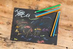 Children sketchpad. On old wood Royalty Free Stock Photos