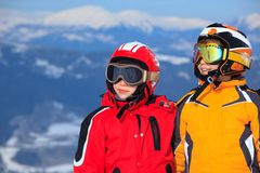 Children in ski clothes stock photography