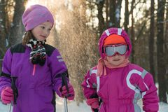 Children skiing in the forest winter snow kids walk in the Park stock image