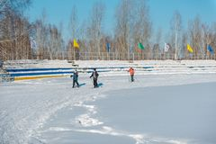 Children skiing. Children skiing. Skiers on the track. Skiing in a circle. Ski Track stock image