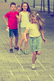 Children skipping hopscotch Royalty Free Stock Images